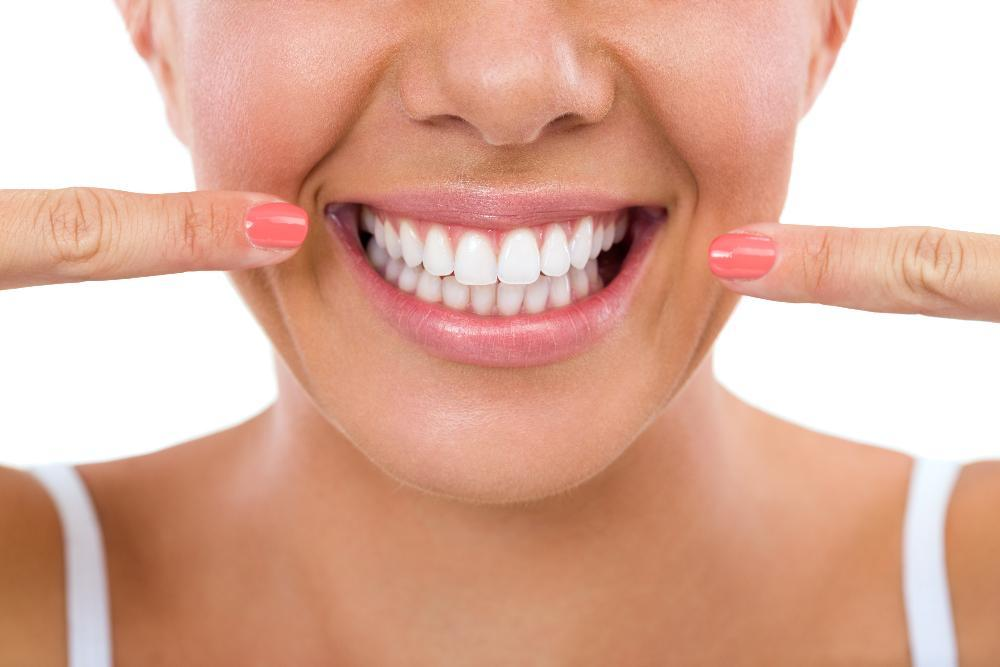 close up of woman's bright smile l dentist 47404