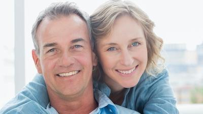 older couple hugging l bloomington cosmetic dentist
